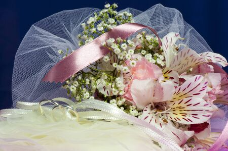 Arrangement with flowers and wedding rings