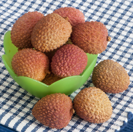 a some lychee in a green container