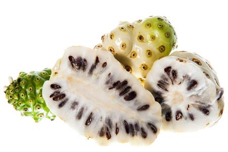 some Morinda citrifolia on a white background