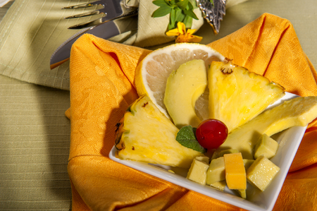 advocated: pineapple and ripe advocated on a green place mat