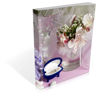 wedding favors: book of  wedding rings and wedding favors on a colorful background