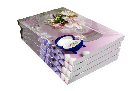 wedding favors: books  of  wedding rings and wedding favors on a colorful background