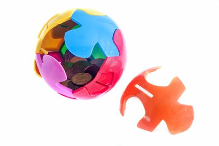 Colorful palladium piggy bank with jigsaw pieces