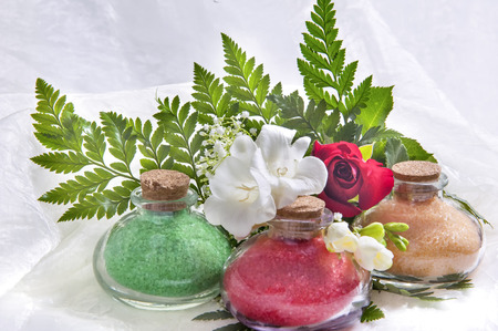 containing: a Glass flasks containing a bath salts Stock Photo