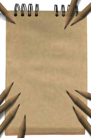 Empty notepad with brown pages with pencils photo