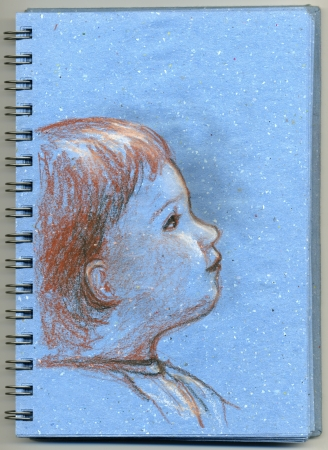 sketchpad: Cute profile of baby, hand made sketch drawn on blue notepad with red pencil