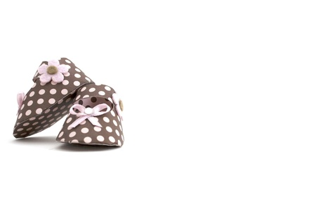 brown clothes: Cute paper baby shoes Stock Photo