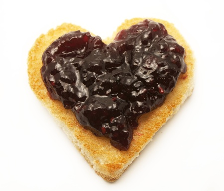 blueberry jam: Jam on heart shape toast