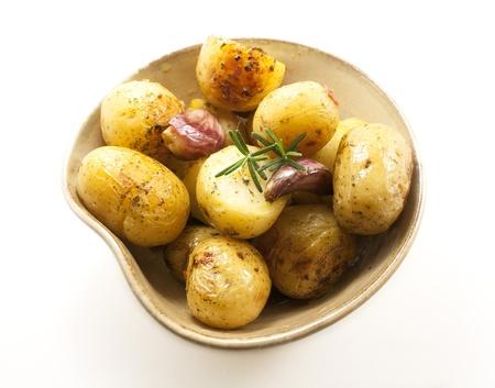 quartered: Roasted baby potatoes bowl  Side dishes   Stock Photo