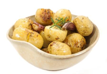 quartered: Roasted potatoes  Side dishes  Stock Photo