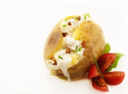 Baked potato isolated on white photo
