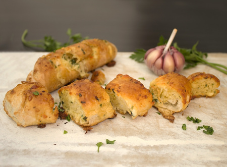 Garlic bread baked with butter and parsley. photo