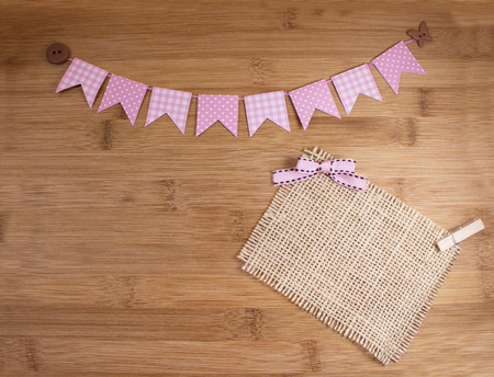 Pink bunting banners on wooden background. Stock Photo