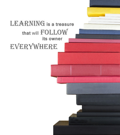 proverb: Books on white background with chinese proverb. Learning is a treasure que will follow its owner everywhere.