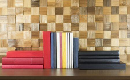 organized: Books organized on wooden shelf Stock Photo