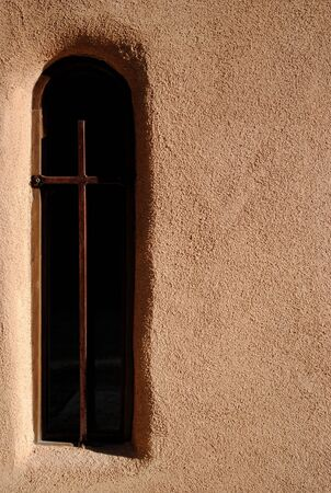 Cross in window of church Stok Fotoğraf
