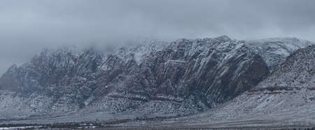 Snow covered desert mountains. Great add-on to sister photo Stok Fotoğraf