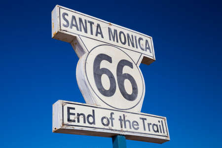 Sign on Santa Monica Pier marking the end of Route 66 Highway, California