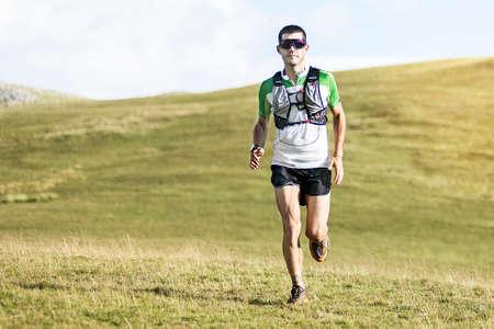 Athlete Runner Runs In Mountain. Sport concept