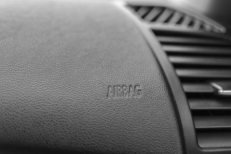 The word  Airbag  is inner beveled on a car photo