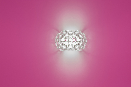 uncoated: wall lamp on a magenta background