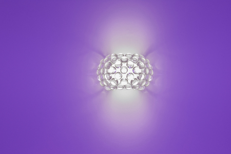 uncoated: wall lamp on a purple background Stock Photo