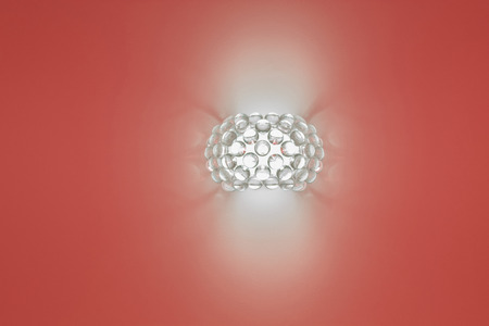 uncoated: wall lamp on a red background Stock Photo