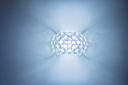 uncoated: wall lamp on a blue background