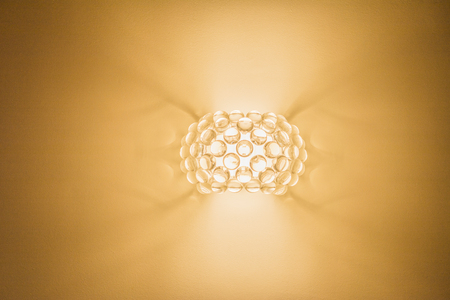 uncoated: wall lamp on an orange background