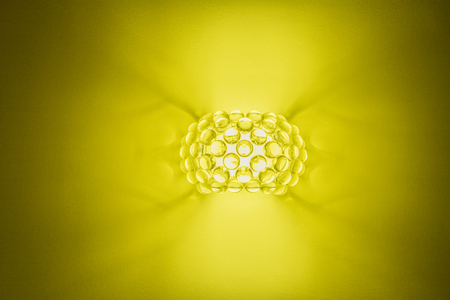 uncoated: wall lamp on a yellow background