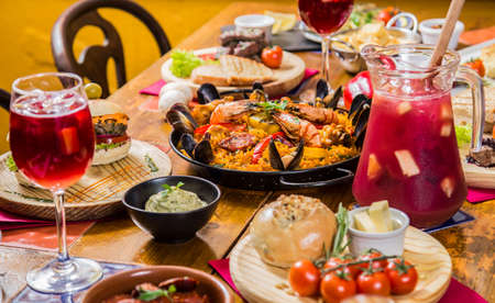 Paella, traditional sangria, wine, Spain, restaurant