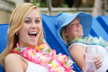 vacationing: Two young women on vacation having fun Stock Photo