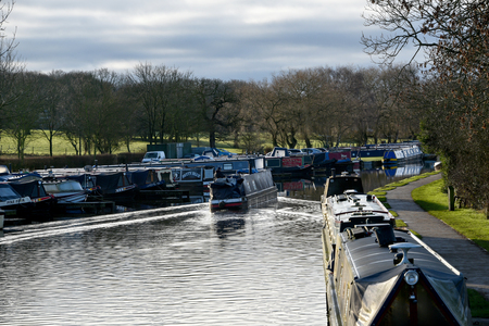 docked: Busy Canal with Canal Boats docked