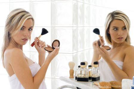 blond girl in front of mirror Stock Photo