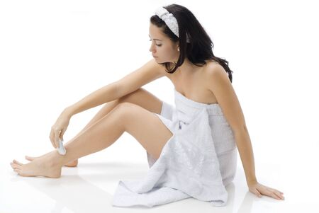 cute and young brunette dressing white towel shaving her legs Stock Photo - 782178