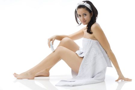 cute and young brunette dressing white towel shaving her legs Stock Photo - 782131