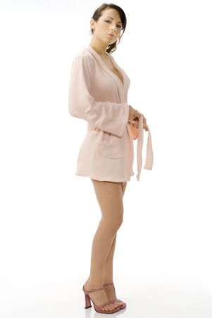 cute and young brunette dressing pink bathrobe with a  on her leg