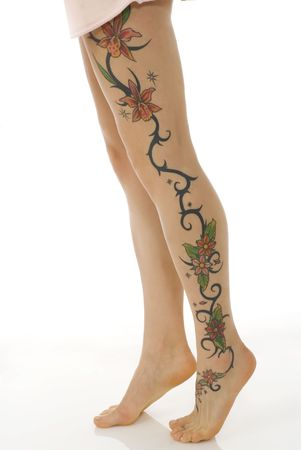 close up of the woman legs with a flower tattoo photo
