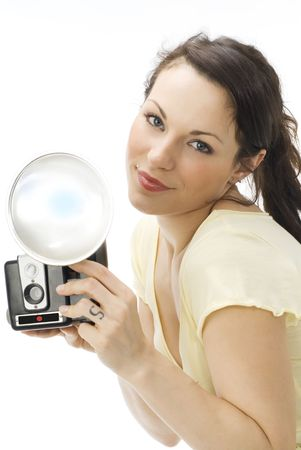 Young beautiful woman holding a photo camera and taking photos photo
