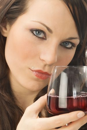 a nice close up of cute and young brunette in a black dress with a glass of  italian red wine photo