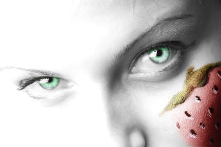 hard look: a nice close up of green eyes in a black and white shot with a strong contrast and a strawberry painted on face
