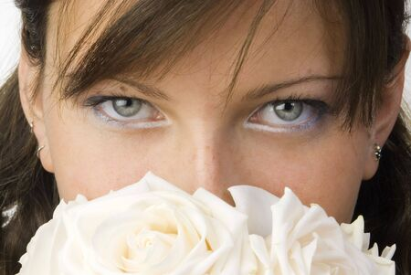 nice and young woman with roses in her hands smelling and smiling with her fair eyes Stock Photo - 958312