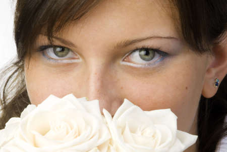 nice and young woman with roses in her hands smelling and smiling with her fair eyes Stock Photo - 958314