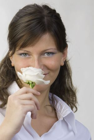 nice and young woman with roses in her hands smelling and smiling with her fair eyes Stock Photo - 958320