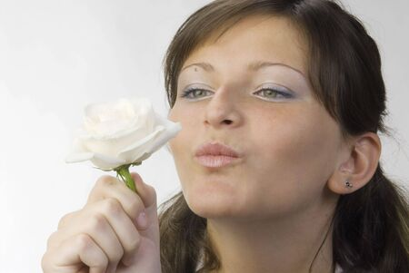 nice and young woman with roses in her hands smelling and smiling with her fair eyes Stock Photo - 958322