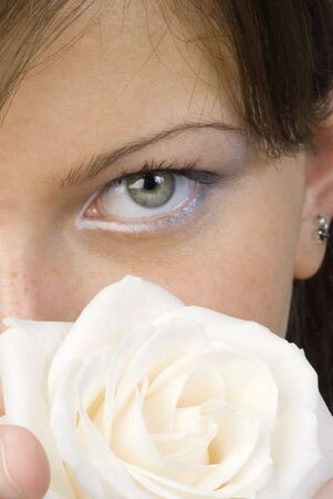 nice and young woman with roses in her hands smelling and smiling with her fair eyes Stock Photo - 958324