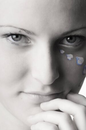 a sweet black and white image of a girl with petals of rose painted on her face and colored eyes Stock Photo - 958329