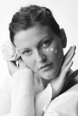 beautiful portrait in black and white of a girl looking sweetly with painted face and a rose in her hand Stock Photo - 958346
