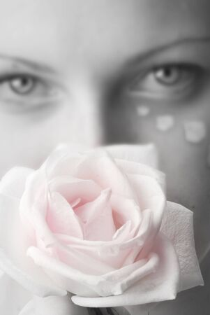 beautiful portrait in black and white of a girl looking sweetly with painted face and a rose in her hand and focus on the rose Stock Photo - 958348