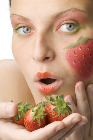 portrait of a young and cute brunette with big strawberry painted on her face and colored eyes Stock Photo - 958364